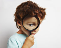 Boy looking through a magnifying glass royalty free stock photography