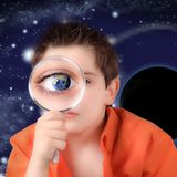 Boy looking with a magnifying glass. Little boy looking with a magnifying glass Royalty Free Stock Photo