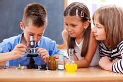 Boy looking into microscope Royalty Free Stock Photography
