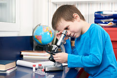 Boy looking in microscope Stock Image