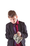 Boy looking for money in the bag Royalty Free Stock Image