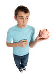 Boy looking at money box Royalty Free Stock Images