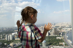Boy looking at Moscow Stock Image