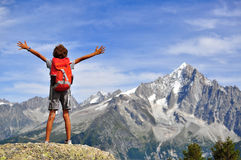 Boy looking at mountains Stock Photo