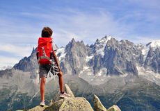 Boy looking at mountains Stock Images