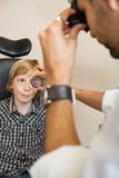 Boy Looking At Optician Examining His Eyes Through Royalty Free Stock Image