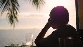 Boy looking out into the distance at sunset. viewpoint. panoramic view stock video
