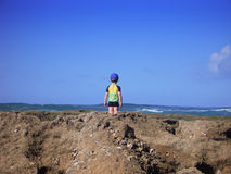Boy looking out to sea Stock Image