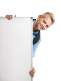 Boy looking out whiteboard. Portrait of happy young schoolboy looking out whiteboard Royalty Free Stock Images
