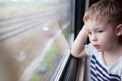 Boy looking out the window of train Stock Image