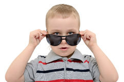 Boy looking over his glasses on a white background Royalty Free Stock Photos