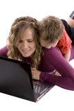 Boy looking over moms shoulder Stock Photos