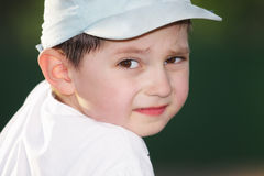 Boy looking over shoulder Royalty Free Stock Image