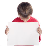 Boy looking at placard Royalty Free Stock Photography