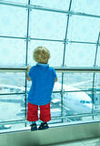 Boy looking at planes in the airport. Boy looking at planes in the Dubai International airport Stock Image