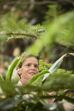 Boy Looking At Plants In Forest Stock Photography