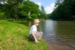 Boy looking the river Stock Photography