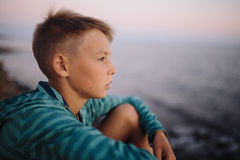 Boy looking at the sea Stock Photos