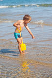 Boy looking for sea shells Royalty Free Stock Photography