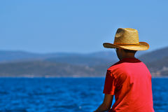 Boy looking at the sea Stock Photography
