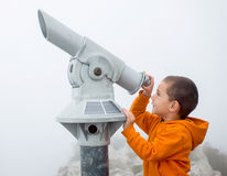Boy looking into the sky Stock Photo