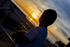 Boy looking at sunset Royalty Free Stock Photo