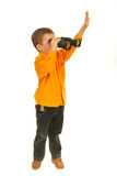 Boy looking throught binocular Stock Photos
