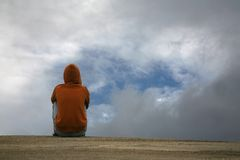 Boy looking to the sky. In a stormy day Stock Photos