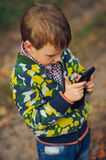Boy looking to smartphone in your hand Stock Photos
