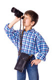 Boy looking to spyglass Royalty Free Stock Image