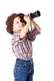 Boy looking to spyglass Royalty Free Stock Photo