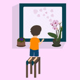 Boy looking to a window Royalty Free Stock Images