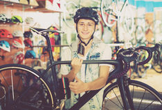 Boy looking for and trying new racing bicycle Royalty Free Stock Image