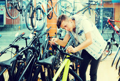 Boy looking for and trying new racing bicycle Royalty Free Stock Photography