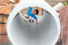 Boy looking through a tube Royalty Free Stock Images