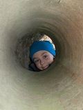 Boy looking tube and smiling Royalty Free Stock Photography