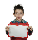 Boy looking up and holds white board Royalty Free Stock Image