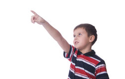 Boy looking up and pointing up Royalty Free Stock Image