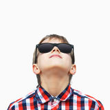 Boy looking up. Portrait of a happy boy in sunglasses looking up, white background Stock Images