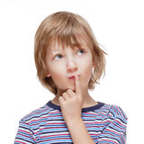 Boy Looking up Thinking, Finger on his Mouth Royalty Free Stock Image