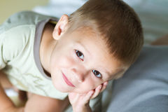 Boy looking up and thinking Stock Photography