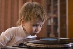 Boy Looking At Vinyl Record Royalty Free Stock Image
