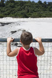 Boy looking for volcanic activity Royalty Free Stock Photo
