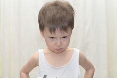 Boy looks askance Royalty Free Stock Photo