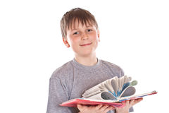 Boy looks at the book Royalty Free Stock Image