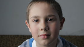 The boy looks at the camera. Little boy looks at the camera stock video footage