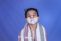 Boy looks at cream on his nose. Royalty Free Stock Photos