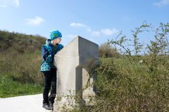 Boy looks at description of sights of Chersonese. In spring stock image