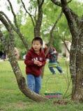 A boy looks for Easter eggs Stock Photos