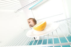 Boy Looks Empty Refrigerator Stock Photo